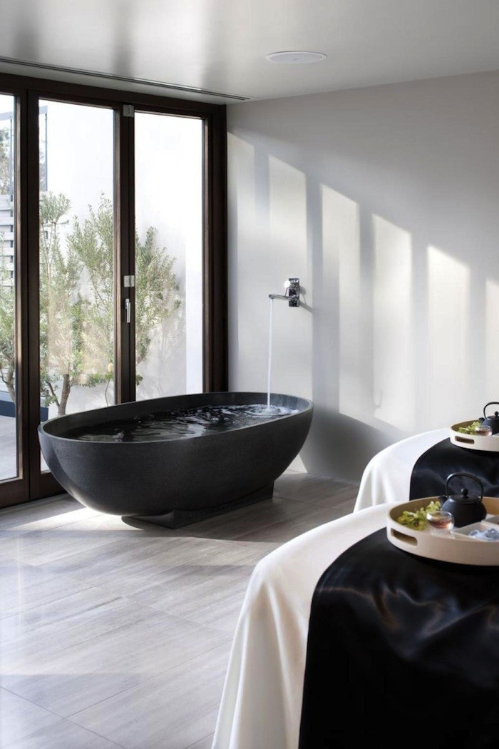 Black bath tubs an elegant statement the design library for Dark bathrooms design